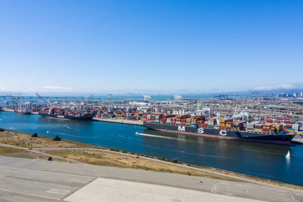 Aerial view of Oakland Container Ships Aerial view of containers and container ships in the Oakland port. Ships docked in the Oakland Estuary on a sunny day. Contaners as far as the eye can see. alameda california stock pictures, royalty-free photos & images