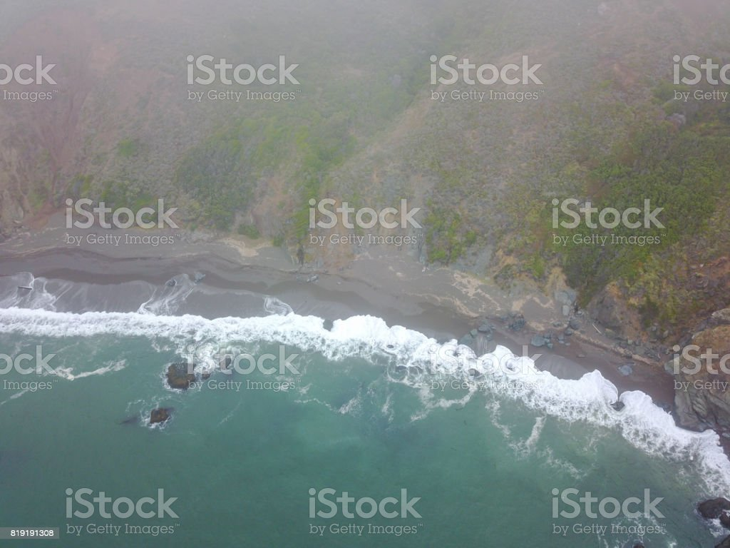 Aerial View of Ocean and Northern California Coast The cold waters of the Pacific Ocean wash against the scenic coast of the Marin Headlands just north of San Francisco. Adventure Stock Photo