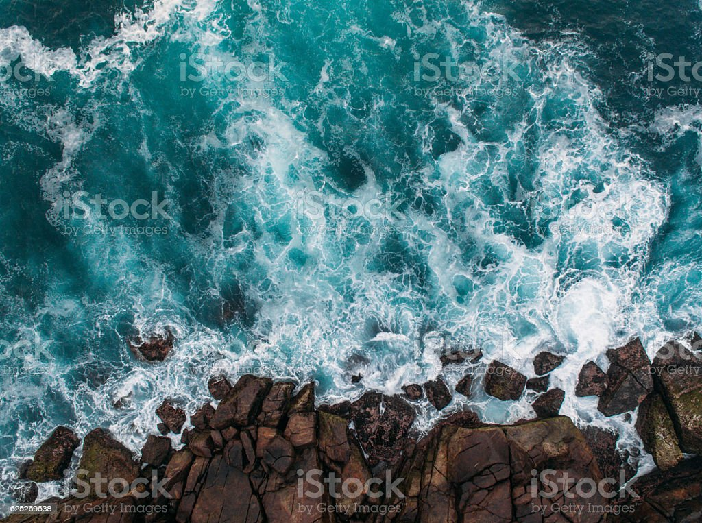 Aerial view of ocean waves and fantastic Rocky coast stock photo