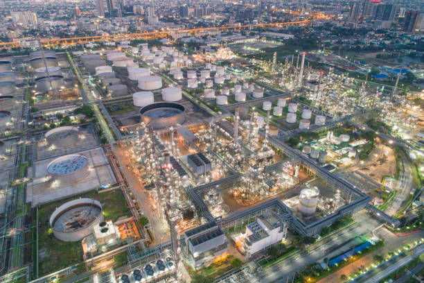 Aerial view of Oil refinery and gas industry in Petrochemical plant at twilight stock photo