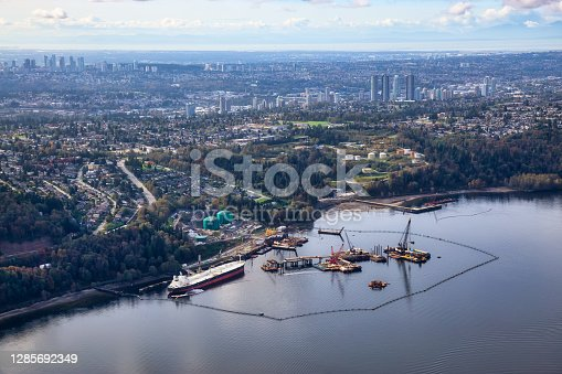 Aerial view of Oil Refinery Industry in Port Moody, Greater Vancouver, British Columbia, Canada. Taken during a sunny summer morning.