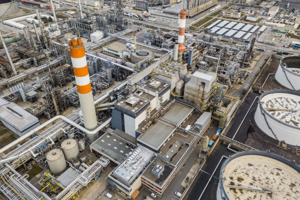 Aerial view of oil refinery Aerial drone view of huge oil refinery chemical plant stock pictures, royalty-free photos & images