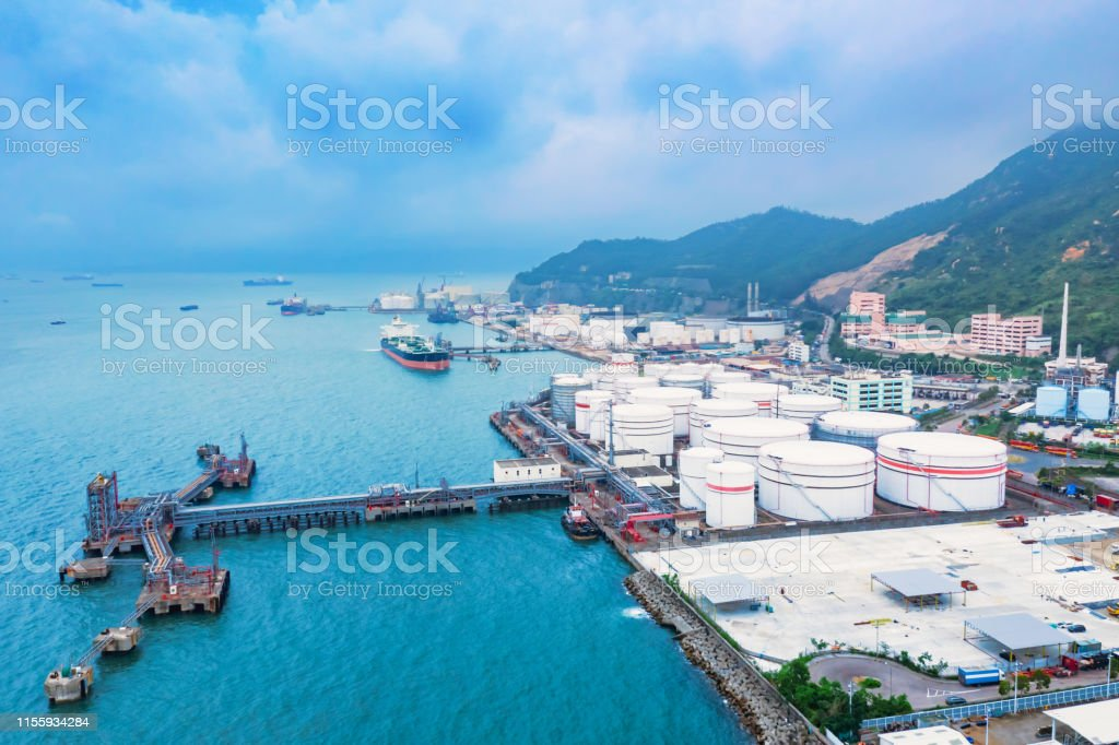 Aerial view of oil storage tank and pipeline steel and oil tanker
