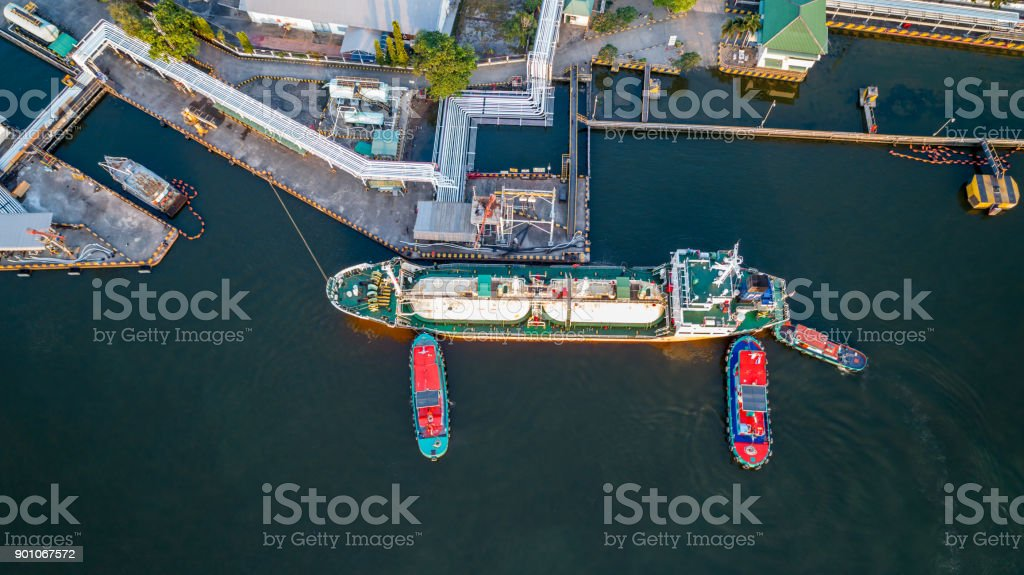 Aerial view of Oil tanker ship loading in port, Oil and gas transport...
