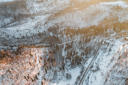Aerial view of the gorge in the Owl Mountains, the Central Sudetes mountain range in south-west Poland. Between the trees in the center of the photo an old brick rack railway bridge.