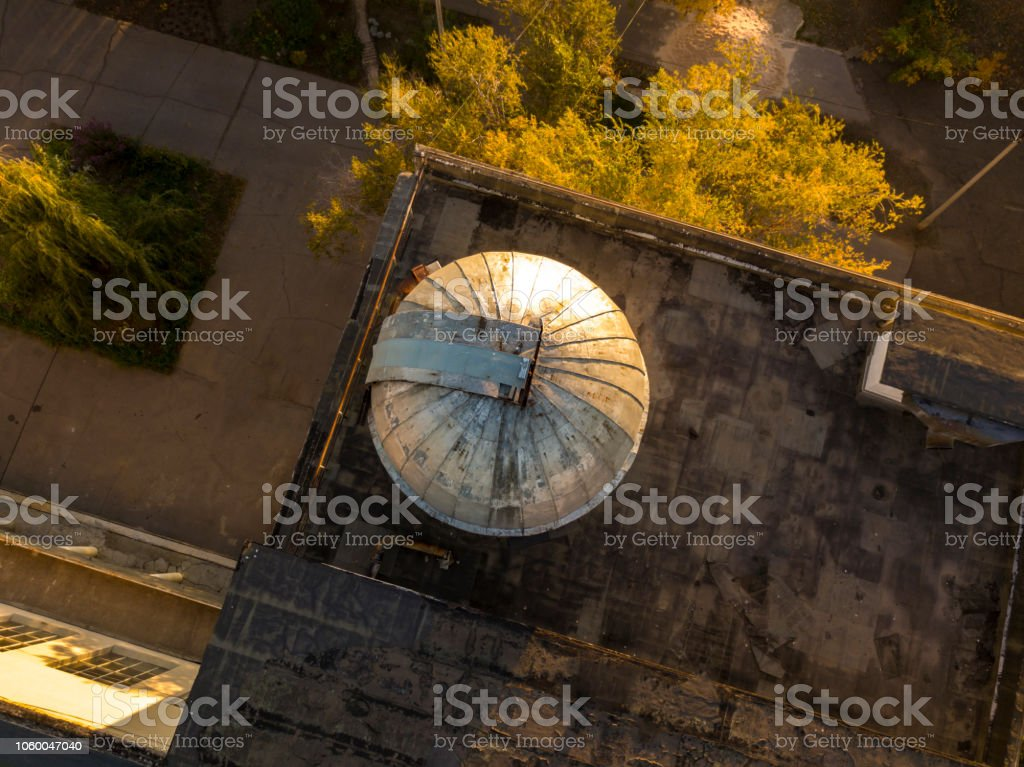 aerial view of old obserbatory dome with telescope inside  f stock photo