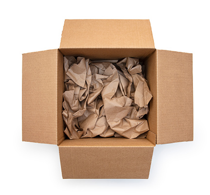 This is an overhead photograph of an open brown cardboard shipping box with crumpled brown paper inside isolated on a white background. This photo will allow you to drp your own product inside the box