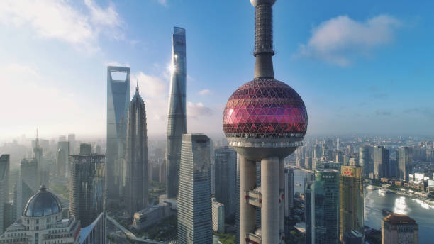 Aerial View of Oriental Pearl TV Tower in Shanghai after Sunrise Photo by Dji Phantom 4pro after sunrise. the bund stock pictures, royalty-free photos & images