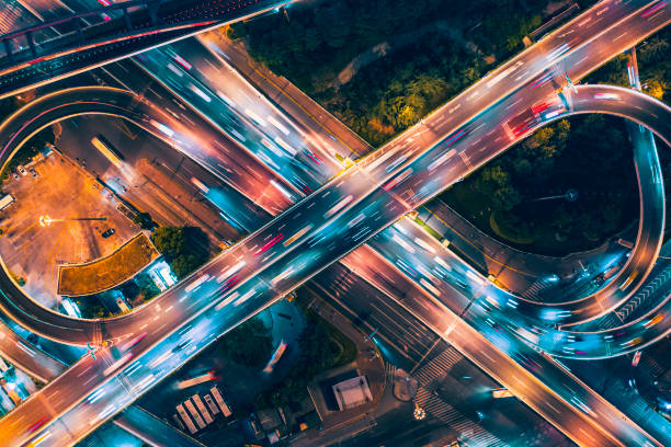 Aerial view of overpass at night Multiple Lane Highway, Overpass, Elevated Road, Road, Road Intersection,infinity symbol elevated road stock pictures, royalty-free photos & images