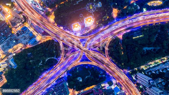 istock Aerial view of overpass at night 695552552