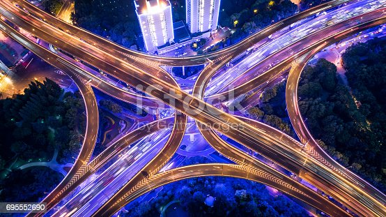 istock Aerial view of overpass at night 695552690