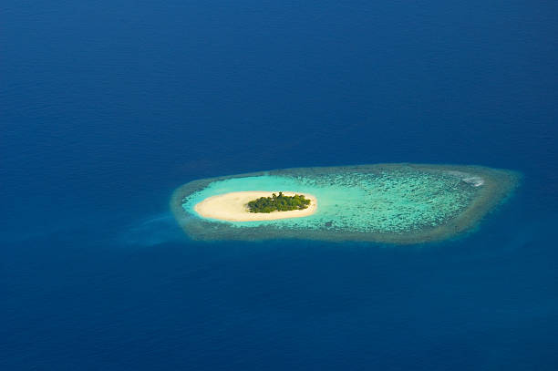 aerial view of paradise island maledivian on blue ocean - desert island stock photos and pictures