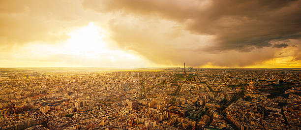 Aerial View of Paris at Sunset with Dramatic Storm Clouds - Photo