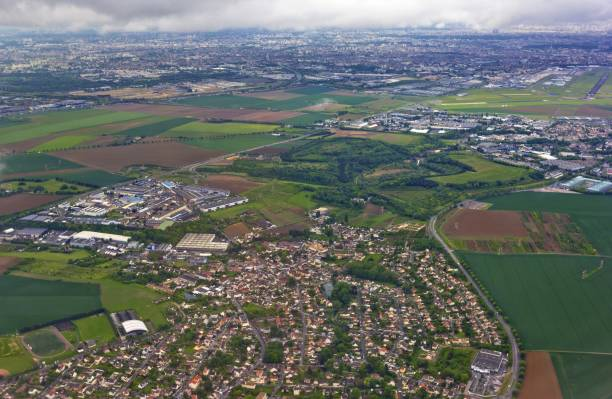Aerial view of Paris outskirts taken from airplane, France Aerial view of Paris outskirts taken from airplane, France val d'oise stock pictures, royalty-free photos & images