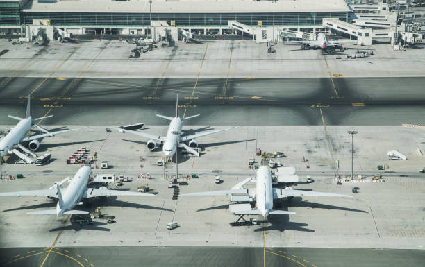 aerial view of parked airplanes in the airport terminal. - airport terminal stock photos and pictures