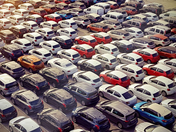 aerial view of parked cars - large group of objects stock photos and pictures