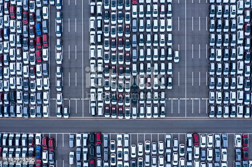 1142724396 istock photo Aerial View of parking 1142724395