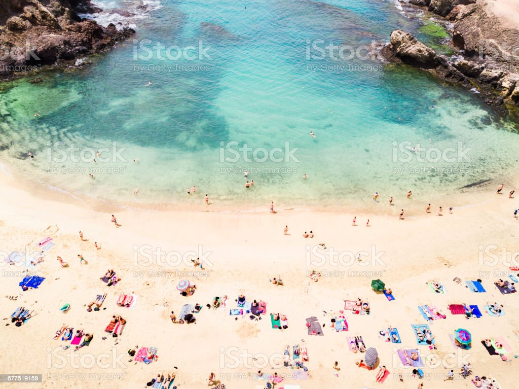 Aerial view of people at the beach royalty-free stock photo