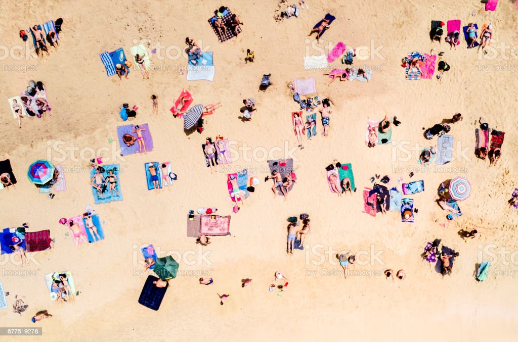 Aerial view of people at the beach stock photo