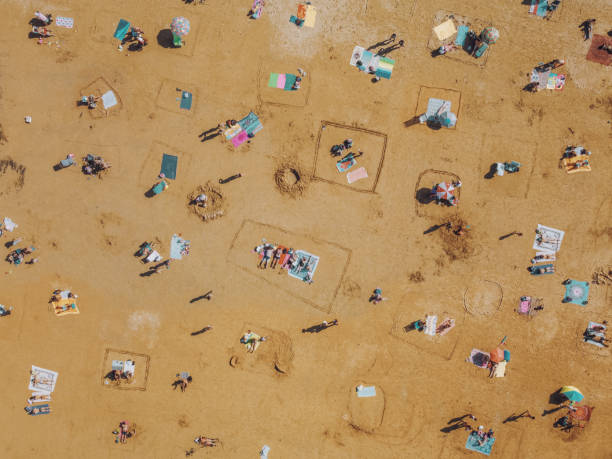 Aerial View of People Social Distancing at the Beach stock photo