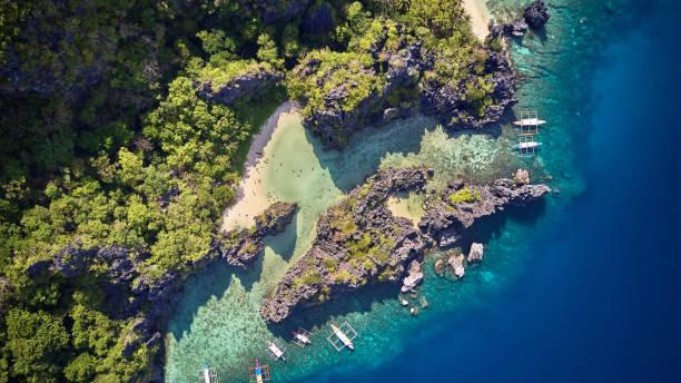 Aerial View of people swimming at Hidden Beach, El Nido, Palawan, Philippines stock photo