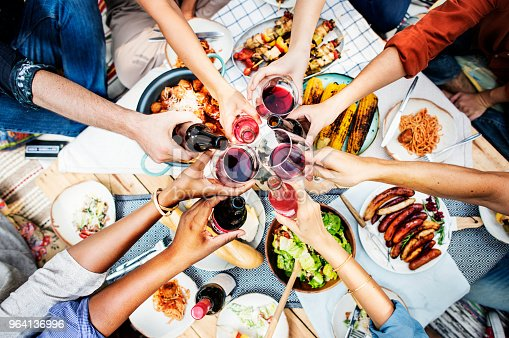 istock Aerial view of people toasting together 964136996