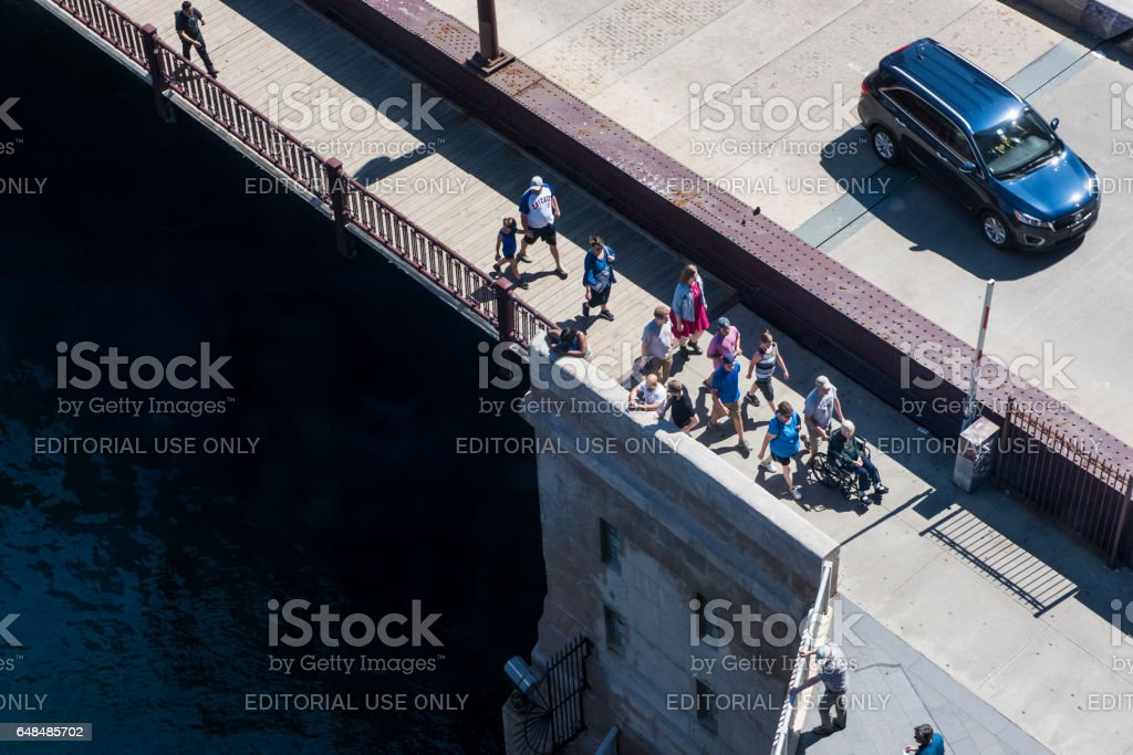 Aerial view of people walking on DuSable bridge in downtown stock photo