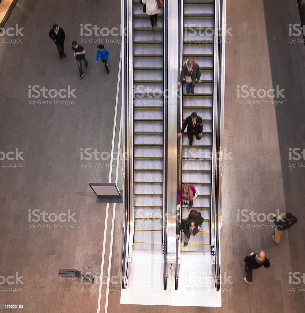 Aerial view of people walking on escalator stock photo