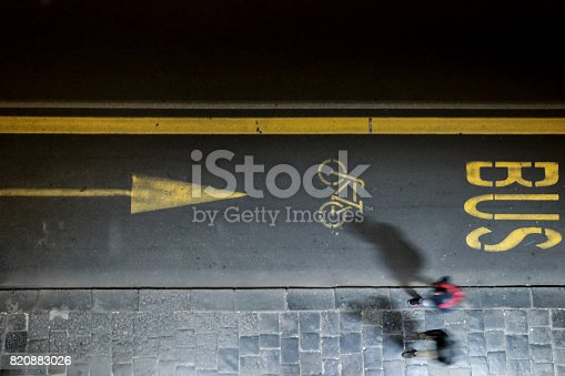 820883024 istock photo aerial view of people walking on road in evening 820883026