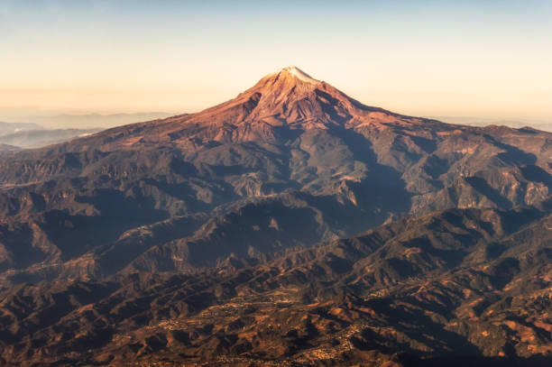 Aerial view of Pico De Orizaba Aerial view of Citlaltepetl, in Spanish Pico de Orizaba, the highest mountain in Mexico and the third highest in North America. orizaba stock pictures, royalty-free photos & images