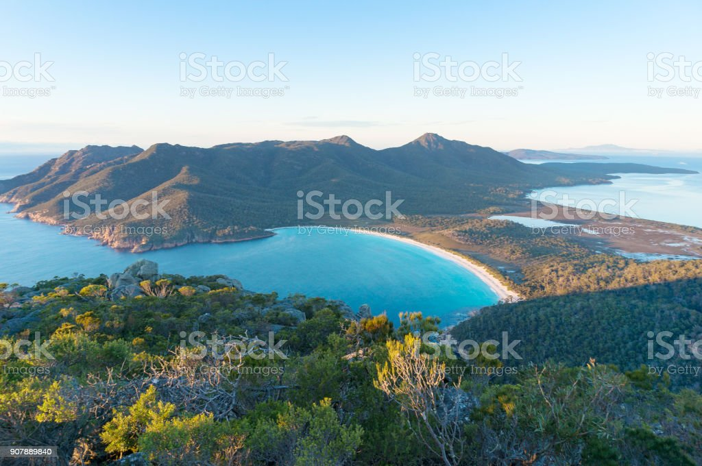 Aerial view of picturesque beach and mountains Aerial view of picturesque beach and mountains on sunny morning. Freycinet Park, Tasmania. Australia Aerial View Stock Photo