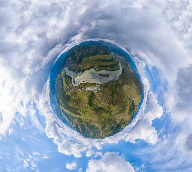 aerial view of planet earth with the image of nature and picturesque landscapes near a mountain and river on a summer day with white clouds and blue sky. - objetiva olho de peixe imagens e fotografias de stock