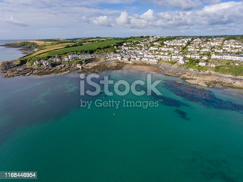 1130689824 istock photo Aerial view of Porthscatho fishing village, Cornwall by drone 1168446954