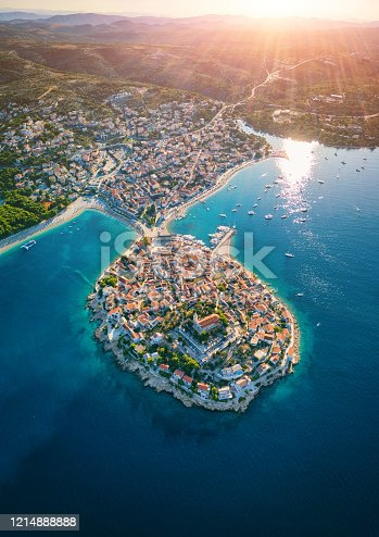 Aerial view of Primosten old town on the islet, amazing sunny landscape, Dalmatia, Croatia. Famous tourist resort on Adriatic sea coast, vertical travel background