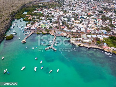 Aerial view of  the harbor and main pier Puerto Ayora, Santa Cruz Island, Galapagos. Puerto Ayora is the most populous town in the Galapagos Islands, the population is about 15000 people.