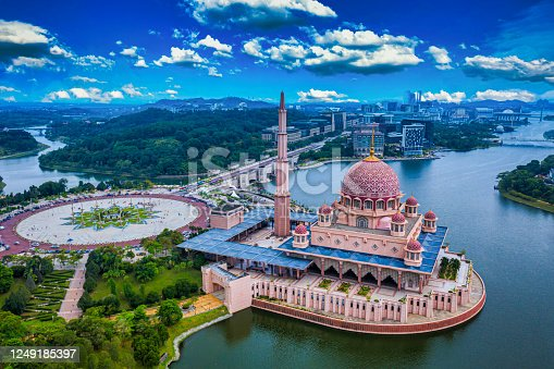 Aerial View Of Putra Mosque with Putrajaya City Centre with Lake at sunset in Putrajaya, Malaysia.