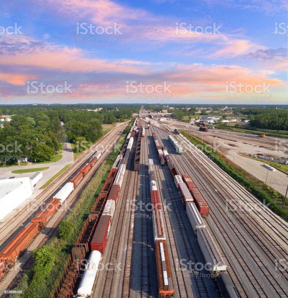 aerial view of railroad rail yard, many trains, tracks. stock photo