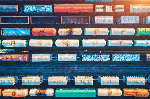 istock Aerial view of railway wagons. Cargo trains. Top view of colorful freight train on the railway station. Wagons with goods on railroad. Heavy industry. Industrial conceptual landscape. Transportation 1146972154