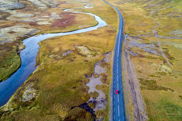Aerial View of Red Car Driving on Road in Iceland stock photo