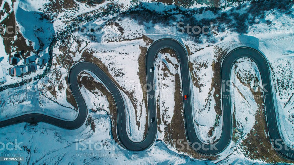 Aerial view of red car on  Julier pass in Switzerland stock photo