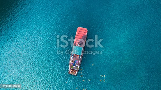 1066331604 istock photo Aerial view of red cruise ship and tourists swimming in the turquoise sea in Vietnam 1200495634