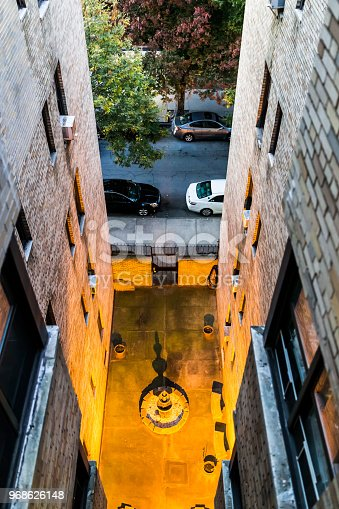 istock Aerial view of residential apartment building and street road with sidewalk between in downtown Fordham Heights area 968626148