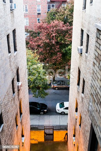 istock Aerial view of residential apartment building and street road with sidewalk between in downtown Fordham Heights area 968626282