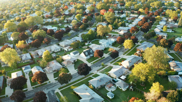 aerial view of residential houses at autumn (october). american neighborhood, suburb. real estate, drone shots, sunset, sunny morning,  sunlight, from above - casa imagens e fotografias de stock