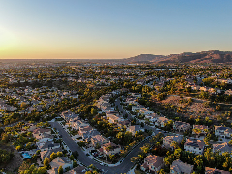 Aerial view of residential modern subdivision during sunset