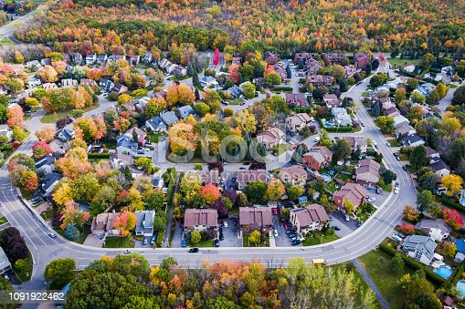Aerial view of houses in residential neighbourhood in the suburbs of Montreal during Fall season, Quebec, Canada.