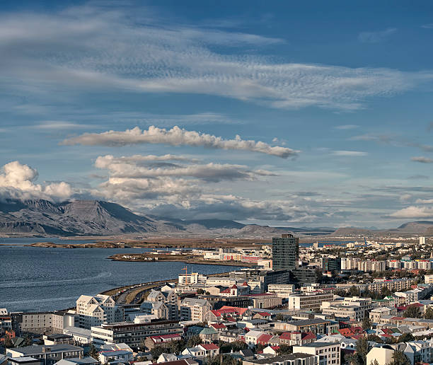 Aerial view of Reykjavik Iceland skyline harbor and mountains stock photo