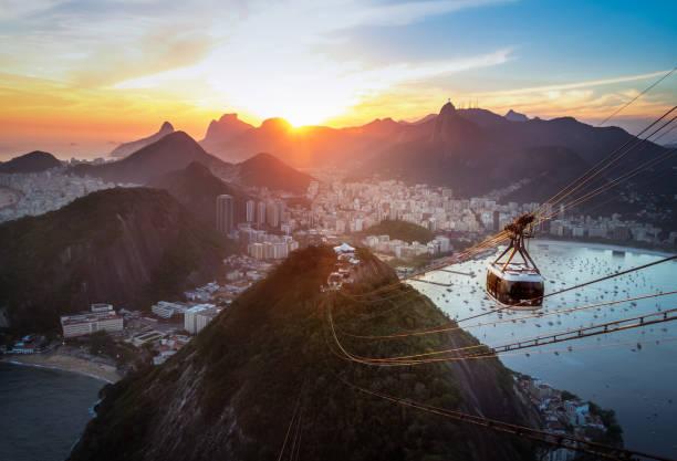Aerial view of Rio de Janeiro at sunset with Urca and Sugar Loaf Cable Car and Corcovado mountain  - Rio de Janeiro, Brazil stock photo