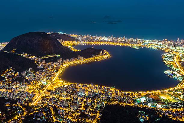 Aerial view of Rio de Janeiro, by night Aerial view of Rio de Janeiro, by night. Copacabana, Ipanema, Leblon and Lagoa neighborhoods border Rodrigo de Freitas lagoon lagoa rio de janeiro stock pictures, royalty-free photos & images