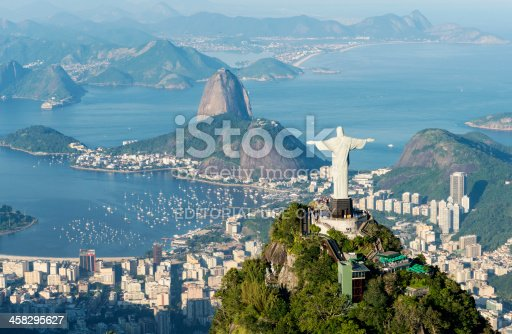 Rio de Janeiro, Brazil - June 6th, 2013: Aerial view from a helicopter of the city of Rio de Janeiro with the Corcovado mountain and the statue of Christ the Redeemer with Sugarloaf mountain in the background.